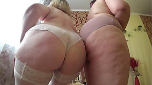 Sexual foreplay of two matured lesbians with fat asses, gradual undressing and caress.
