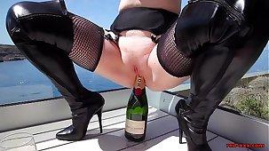 Mature Red XXX fucks a champagne repress outside