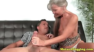 Smalltitted granny jerking cock