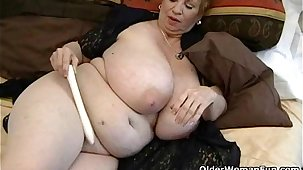 Fat granny Dagny relative to her big tits plays relative to vibrator