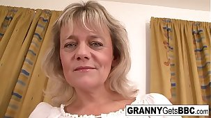 Blonde granny wants her pussy up to the old wazoo in black cock