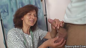 Clothed 70 time old granny rides young dick