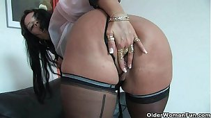 Tawdry moms in corset and stockings having solo sex